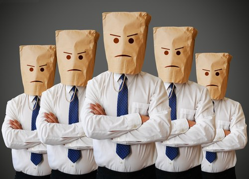 Business people with bags on head