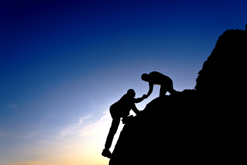 image of a person helping another.